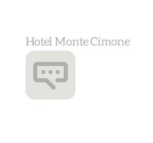 <span>Testimonianza Hotel Monte Cimone</span><i>→</i>